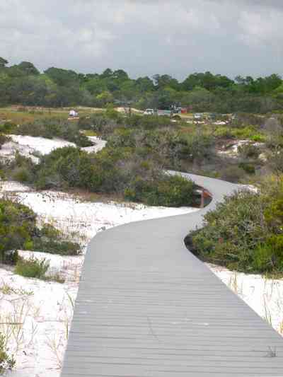 Gulf-Islands-National-Seashore:-Dunes-Nature-Trail_04.jpg:  walkway, boardwalk, parking lot, quartz sand, dunes, gulf of mexico, barrier island
