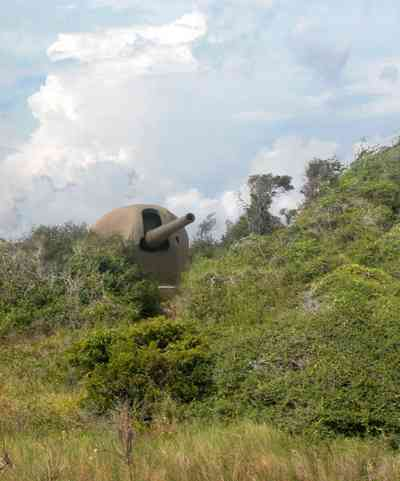 Gulf-Islands-National-Seashore:-Fort-Pickens:-Battery-234_00b.jpg:  gulf of mexico, ww-ii gun emplacement, cumulus clouds, dunes