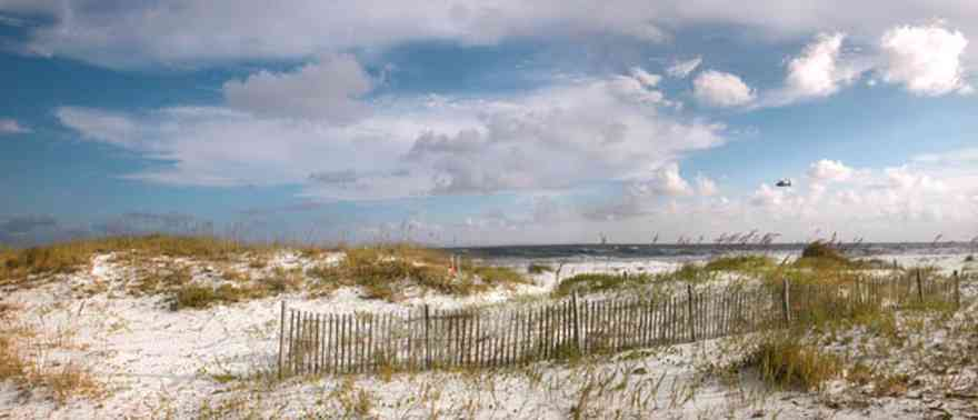 Gulf-Islands-National-Seashore:-Opal-Beach-Sign_01.jpg:  dune fence, dunes, gulf of mexico, sea oats, cirrus clouds, mixed skies, national seashore