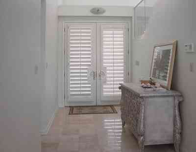 Pensacola-Beach:-1212-Ariola-Drive_02.jpg:  front door, travitine marble floor, foyer, hall, beach house, pensacola beach, gulf of mexico