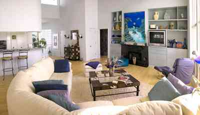 Pensacola-Beach:-Ariola-Drive-Art-Deco-House_30a.jpg:  beachfront home, gulf of mexico, sectional sofa, coffee table, foot stool, hassock, bean bag chair, bar chairs, marble fireplace, tv set, throw pillows, open floor plan