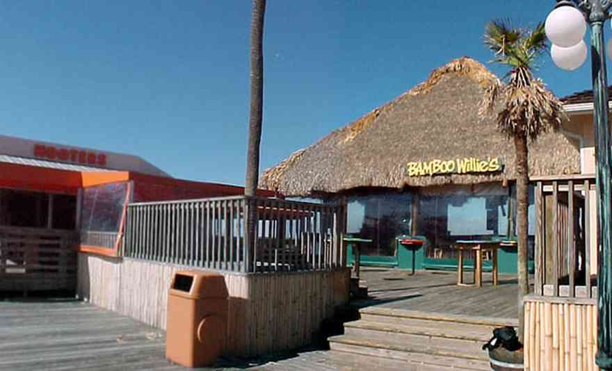 Pensacola-Beach:-Bamboo-Willies_01.jpg:  bamboo hut, palm tree, hooters, boardwalk, gulf of mexico, gulf coast