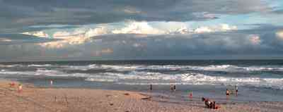 Pensacola-Beach:-Sunset_03.jpg:  surf, waves, gulf of mexico, sand, swimmers, surfers, bathers, sunset, tropical storm