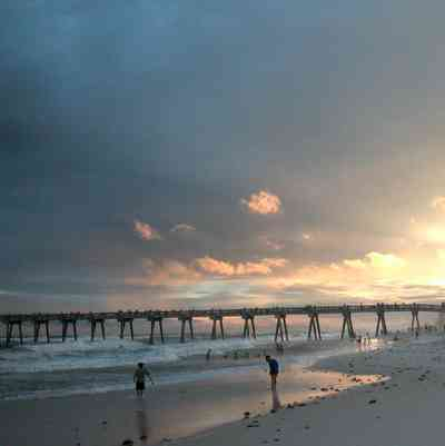 Pensacola-Beach:-Sunset_05.jpg:  fishing pier, mixed skies, surf, bathers, swimmers, tropical storm, mixed skies, gulf of mexico