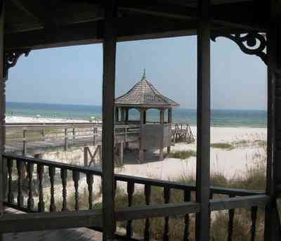 Perdido-Key:-Gothic-House_08b.jpg:  porch, screen porch, summer house, gazebo, cedar shake roof, walkway, pier, deck, gulf of mexico, emerald water, dunes, sea oats, beach